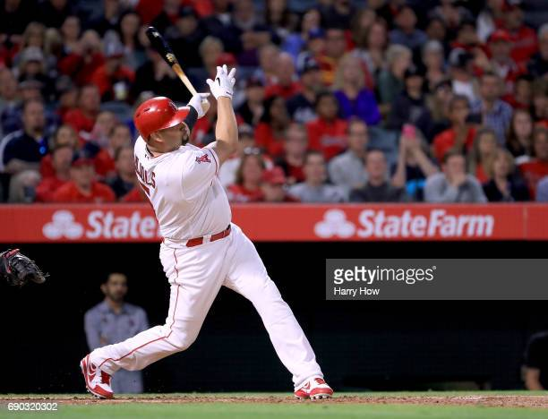 Albert Pujols of the Los Angeles Angels hits his 599th homerun for his career with two men on base to take a 32 lead over the Atlanta Braves during...