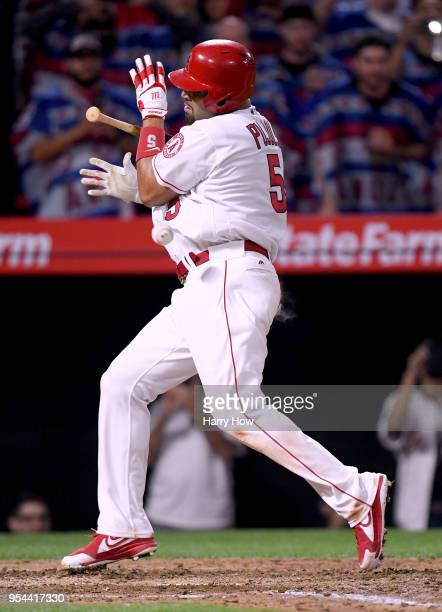 Albert Pujols of the Los Angeles Angels is hit by a pitch with 2999 career hits during the fourth inning against the Baltimore Orioles at Angel...