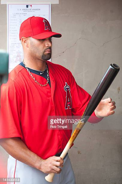 Albert Pujols of the Los Angeles Angels looks on before a spring training game against the Oakland Athletics at Phoenix Municipal Stadium on March 5...