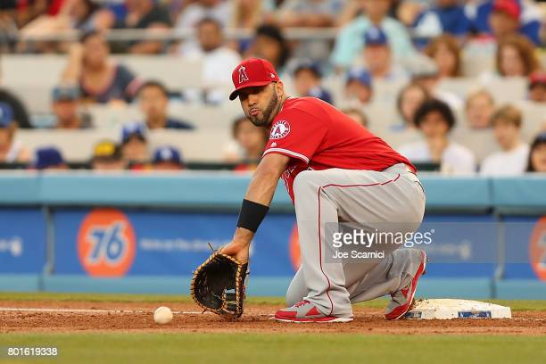 Albert Pujols of the Los Angeles Angels makes a catch at first base in the third inning against the Los Angeles Dodgers at Dodger Stadium on June 26...