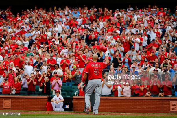 Albert Pujols of the Los Angeles Angels of Anaheim acknowledges a standing ovation from the fans prior to batting against the St. Louis Cardinals at...