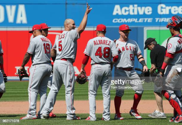Albert Pujols of the Los Angeles Angels of Anaheim and Kole Calhoun celebrate their victory during MLB game action against the Toronto Blue Jays at...