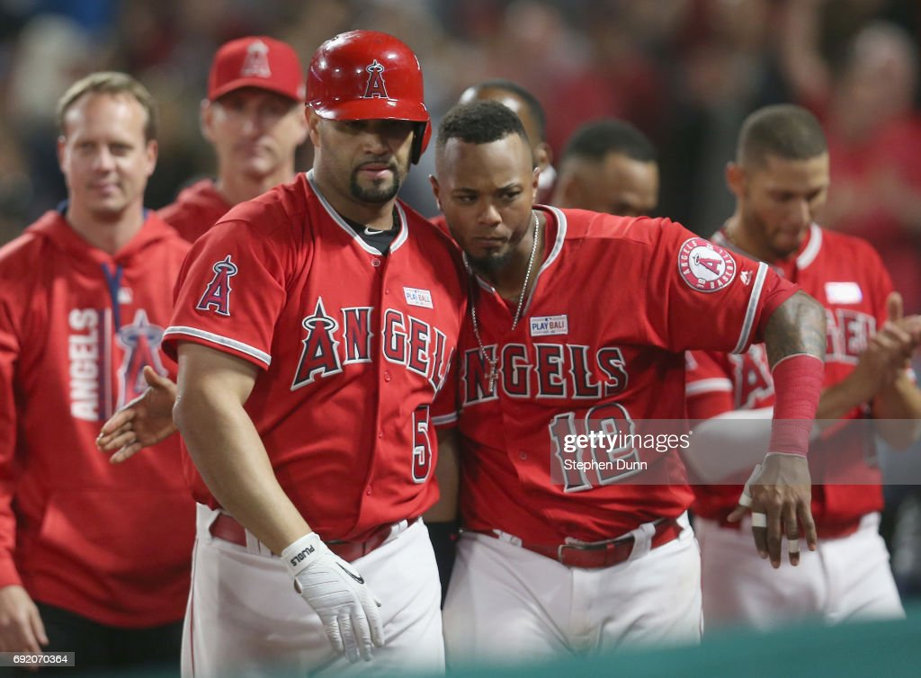 Albert Pujols #5 of the Los Angeles Angels of Anaheim celebrates with Martin Maldonado #12 after Pujols' career home run number 600, a grand slam in the fourth inning against the Minnesota Twins at Angel Stadium of Anaheim on June 3, 2017 in Anaheim, California.