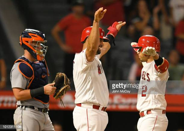 Albert Pujols of the Los Angeles Angels of Anaheim congratulates Andrelton Simmons on his fourth inning home run as James McCann of the Detroit...