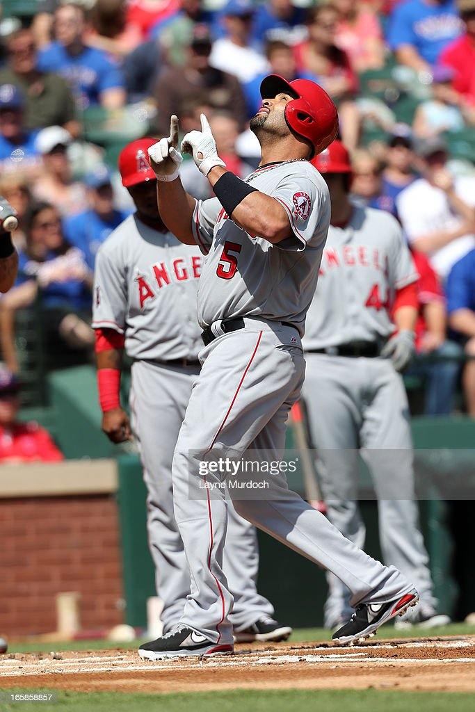 Albert Pujols #5 of the Los Angeles Angels of Anaheim gestures after hitting a two-run homer against Matt Harrison #54 of the Texas Rangers on April 6, 2013 at the Rangers Ballpark in Arlington in Arlington, Texas.