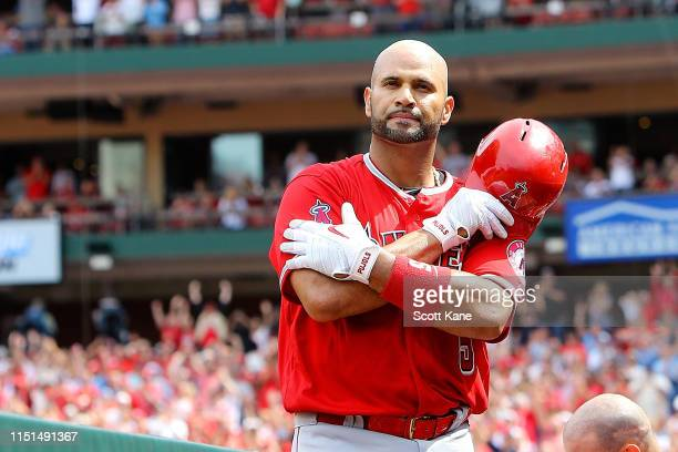 Albert Pujols of the Los Angeles Angels of Anaheim gives fans a curtain call after hitting a solo home run during the seventh inning against the St....
