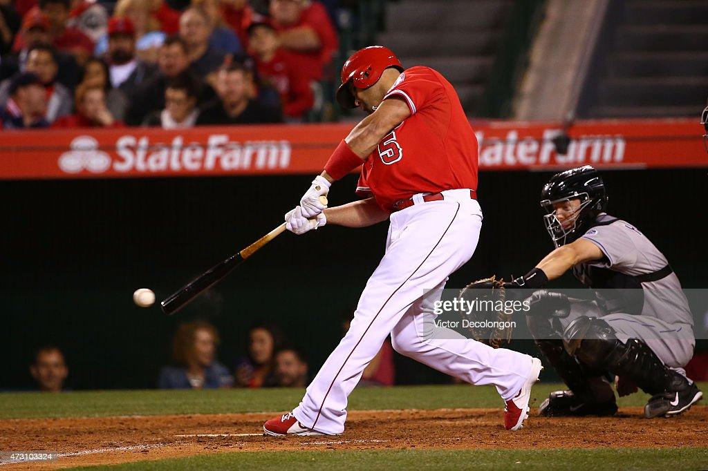 Albert Pujols #5 of the Los Angeles Angels of Anaheim hits a eighth inning single during the MLB game against the Colorado Rockies at Angel Stadium of Anaheim on May 12, 2015 in Anaheim, California. The Angels defeated the Rockies 5-2.