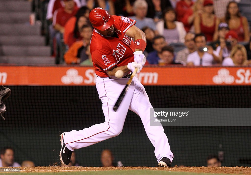 Albert Pujols #5 of the Los Angeles Angels of Anaheim hits a flare down the right field line for a double in the fifth inning against the Seattle Mariners at Angel Stadium of Anaheim on June 5, 2012 in Anaheim, California.
