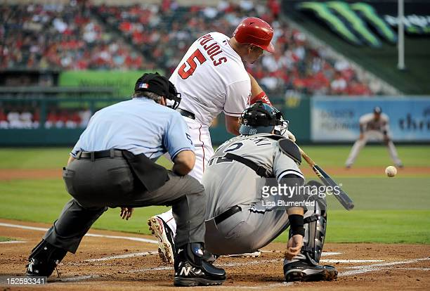 Albert Pujols of the Los Angeles Angels of Anaheim hits a RBI double in the first inning against the Chicago White Sox at Angel Stadium of Anaheim on...