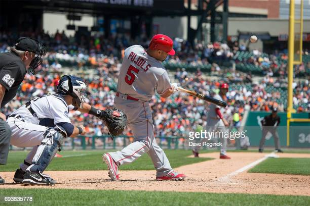 Albert Pujols of the Los Angeles Angels of Anaheim hits a sacrifice fly in the fifth inning during a MLB game against the Detroit Tigers at Comerica...