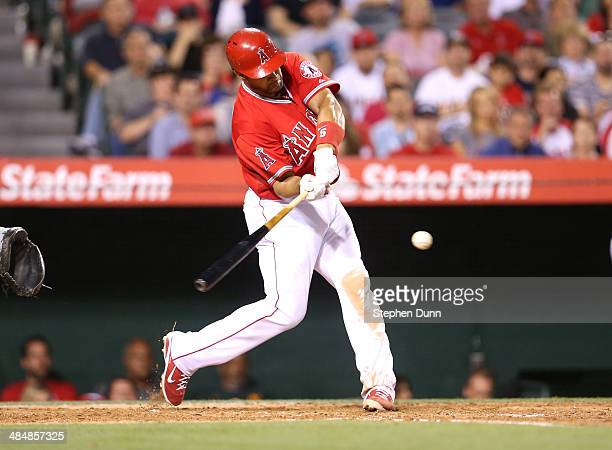 Albert Pujols of the Los Angeles Angels of Anaheim hits a solo home run in the third inning against the Oakland Athletics at Angel Stadium of Anaheim...