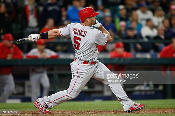 Albert Pujols of the Los Angeles Angels of Anaheim hits a threerun home run against the Seattle Mariners in the ninth inning at Safeco Field on May...