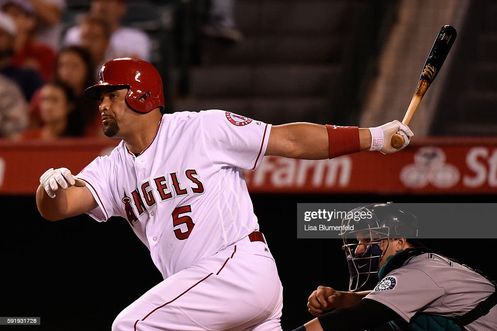 Albert Pujols #5 of the Los Angeles Angels of Anaheim hits a two RBI double in the eighth inning against the Seattle Mariners at Angel Stadium of Anaheim on August 18, 2016 in Anaheim, California.