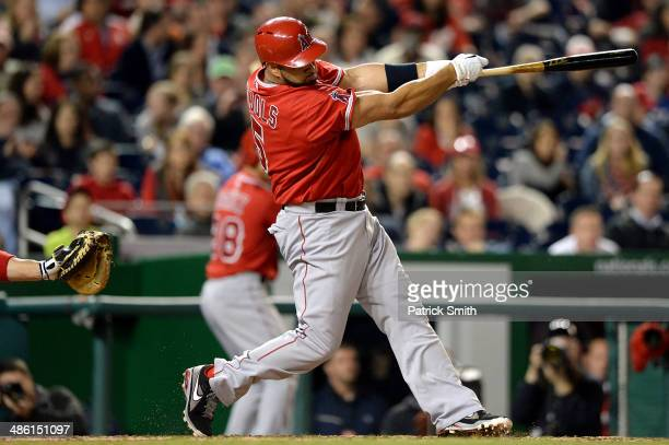 Albert Pujols of the Los Angeles Angels of Anaheim hits a tworun home run against the Washington Nationals in the fifth inning at Nationals Park on...