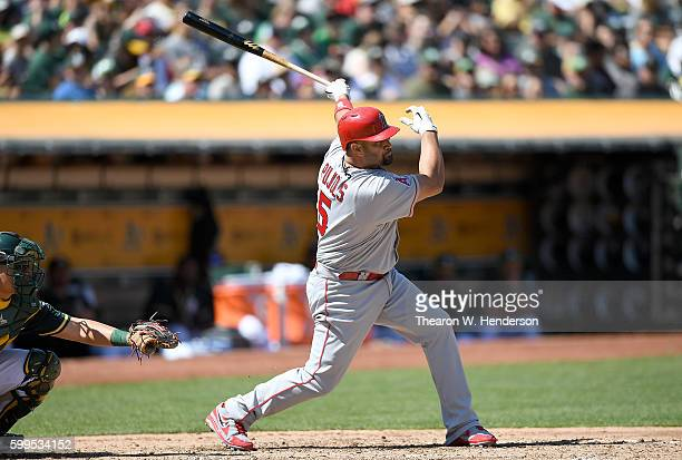 Albert Pujols of the Los Angeles Angels of Anaheim hits a tworun rbi double against the Oakland Athletics in the top of the fourth inning at...