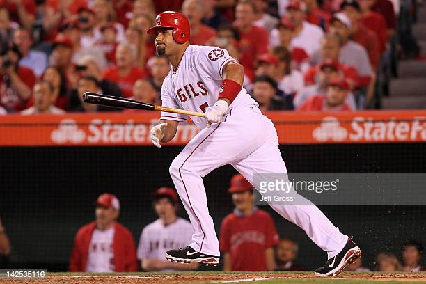 Albert Pujols of the Los Angeles Angels of Anaheim lines out into a doubleplay in the first inning against the Kansas City Royals on Opening Day of...