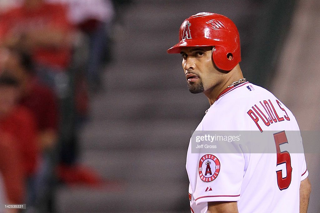 Albert Pujols #5 of the Los Angeles Angels of Anaheim looks over at the dugout while at bat in the second inning against the Kansas City Royals on Opening Day of the 2012 MLB season at Angel Stadium of Anaheim on April 6, 2012 in Anaheim, California.