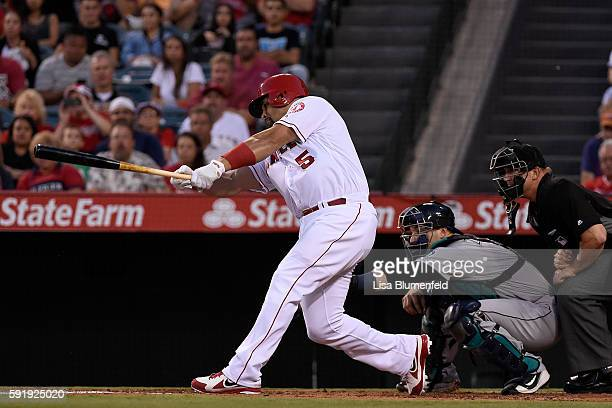 Albert Pujols of the Los Angeles Angels of Anaheim reaches on a force attempt driving in a run in the first inning against the Seattle Mariners at...