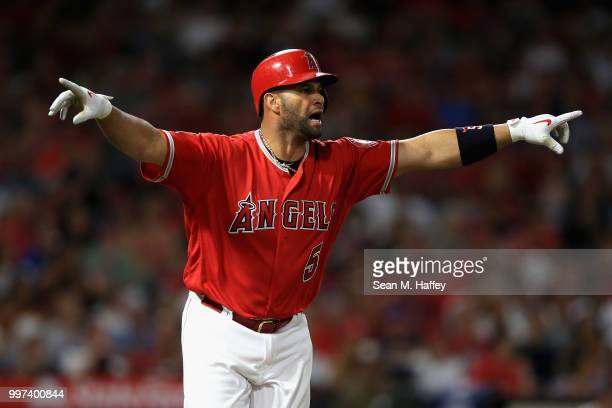 Albert Pujols of the Los Angeles Angels of Anaheim reacts after hitting a single during the fifth inning of a game against the Seattle Mariners at...