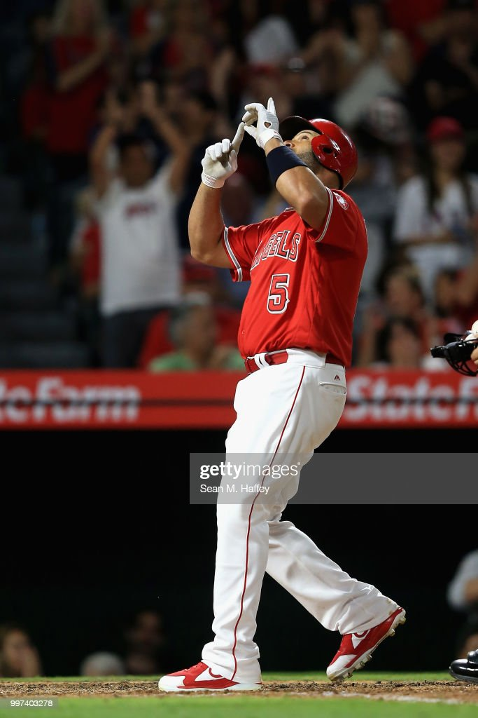 Albert Pujols #5 of the Los Angeles Angels of Anaheim reacts after hitting a solo homerun during the sixth inning of a game against the Seattle Mariners at Angel Stadium on July 12, 2018 in Anaheim, California.