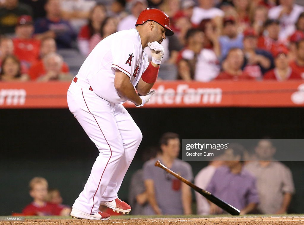 Albert Pujols #5 of the Los Angeles Angels of Anaheim reacts after being hit by a pitch in the fifth inning by pitcher Taijuan Walker of the Seattle Mariners at Angel Stadium of Anaheim on June 26, 2015 in Anaheim, California.