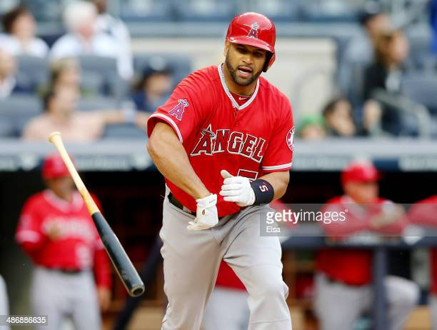 Albert Pujols of the Los Angeles Angels of Anaheim reacts after he flies out to center in the ninth inning against the New York Yankees on April 26...