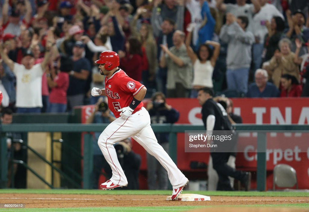 Albert Pujols #5 of the Los Angeles Angels of Anaheim rounds first base after hitting career home run number 600 clears the wall, a grand slam in the fourth inning against the Minnesota Twins at Angel Stadium of Anaheim on June 3, 2017 in Anaheim, California.