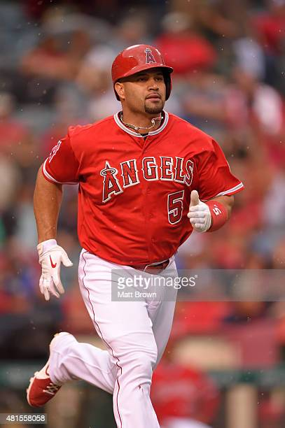Albert Pujols of the Los Angeles Angels of Anaheim runs in the rain during the game against the Boston Red Sox at Angel Stadium of Anaheim on July 18...