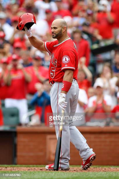 Albert Pujols of the Los Angeles Angels of Anaheim salutes fans as he receives a standing ovation as he approaches the plate to bat din the second...