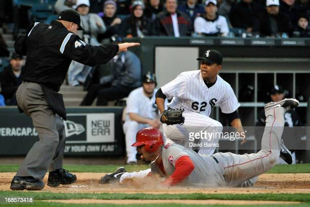Albert Pujols of the Los Angeles Angels of Anaheim scores on a passed ball as Jose Quintana of the Chicago White Sox makes a late tag during the...