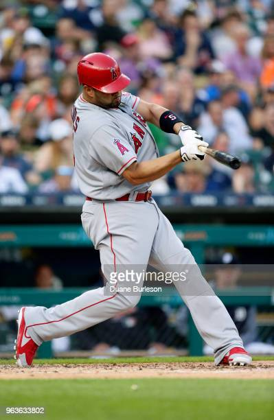 Albert Pujols of the Los Angeles Angels of Anaheim singles against the Detroit Tigers during the third inning at Comerica Park on May 29 2018 in...