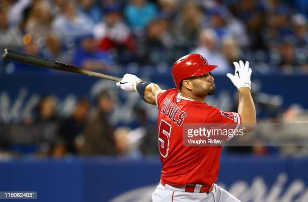 Albert Pujols of the Los Angeles Angels of Anaheim singles in the ninth inning during a MLB game against the Toronto Blue Jays at Rogers Centre on...