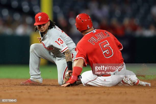 Albert Pujols of the Los Angeles Angels of Anaheim slides safely into second base as Freddy Galvis of the Philadelphia Phillies is late with the tage...