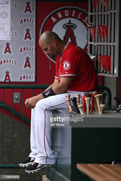 Albert Pujols of the Los Angeles Angels of Anaheim spits as he looks down in the dugout against the Houston Astros at Angel Stadium of Anaheim on...