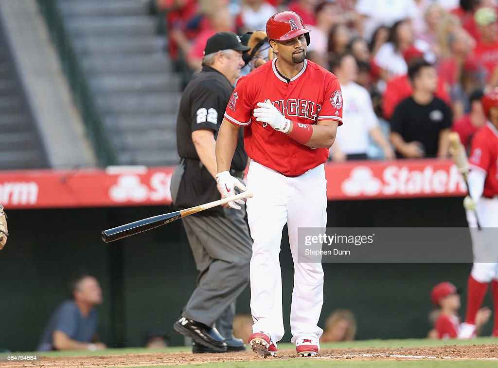 Albert Pujols #5 of the Los Angeles Angels of Anaheim tosses his bat aside after hitting a two run home run in the third inning against the Boston Red Sox at Angel Stadium of Anaheim on July 30, 2016 in Anaheim, California.