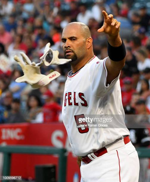 Albert Pujols of the Los Angeles Angels of Anaheim tosses hit batting gloves after striking out in the game against the Chicago White Sox at Angel...