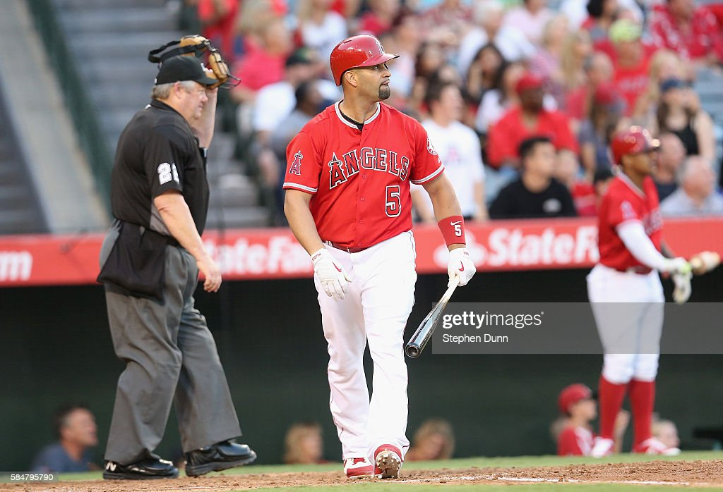 Albert Pujols #5 of the Los Angeles Angels of Anaheim watches his two run home run in the third inning against the Boston Red Sox at Angel Stadium of Anaheim on July 30, 2016 in Anaheim, California.