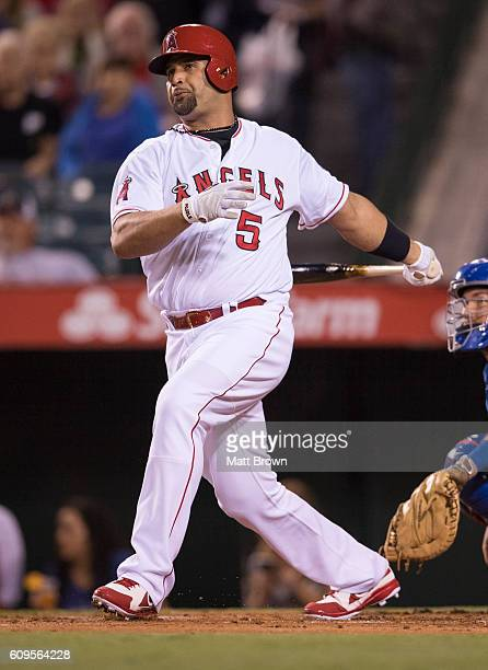 Albert Pujols of the Los Angeles Angels of Anaheim watches the flight of his ball after hitting a double during the first inning of the game against...