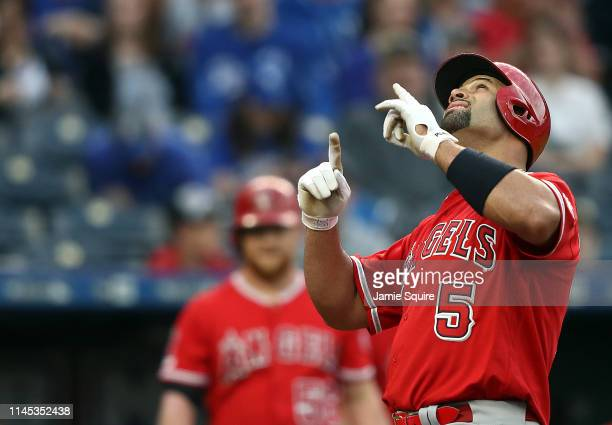 Albert Pujols of the Los Angeles Angels reacts as he crosses home plate after hitting a home run during the 1st inning of the game against the Kansas...