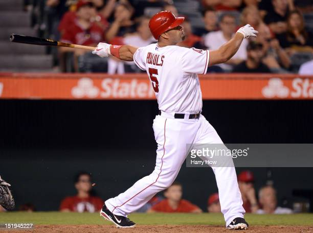 Albert Pujols of the Los Angeles Angels reacts to his homerun to become the first player to hit at least 30 homeruns in each of his first 12 seasons...