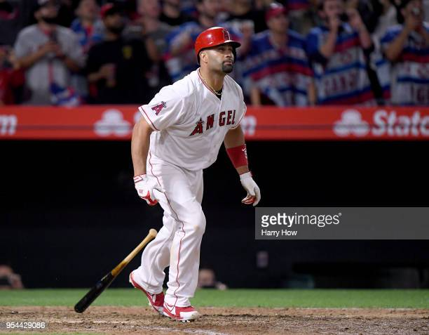 Albert Pujols of the Los Angeles Angels reacts to his pop fly out with 2999 career hits during the ninth inning against the Baltimore Orioles at...