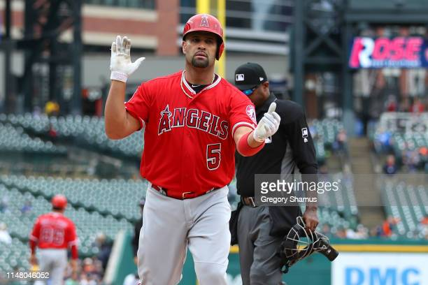 Albert Pujols of the Los Angeles Angels reacts to his third inning solo home run to reach 2000 career RBI's while playing the Detroit Tigers at...