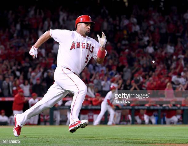 Albert Pujols of the Los Angeles Angels runs as he hits a double for his 2999th career hit during the second inning against the Baltimore Orioles at...