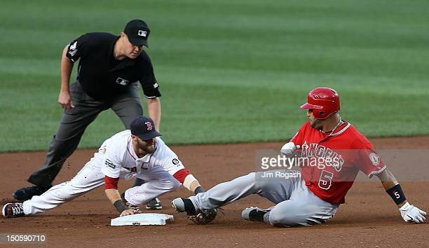 Albert Pujols of the Los Angeles Angels tag out by Dustin Pedroia of the Boston Red Sox in the first inning trying to stretch a single into a double...