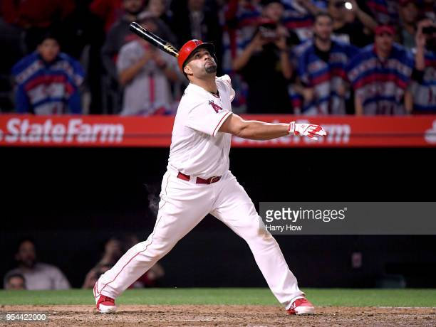 Albert Pujols of the Los Angeles Angels watches his pop fly out with 2999 career hits during the sixth inning against the Baltimore Orioles at Angel...