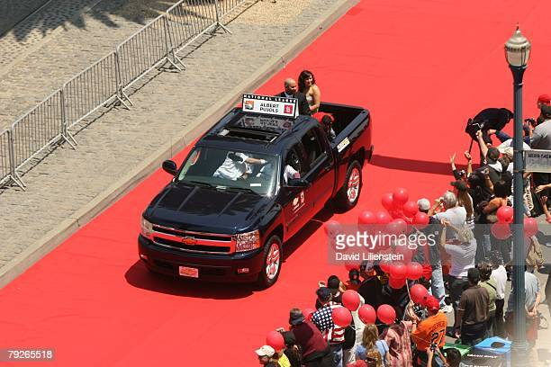 Albert Pujols of the St Louis Cardinals and family ride down the red carpet during the AllStar Red Carpet Show before 78th Major League Baseball...