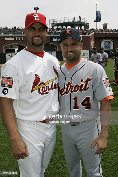 Albert Pujols of the St Louis Cardinals and Placido Polanco of the Detroit Tigers pose together before the 78th Major League Baseball AllStar Game at...