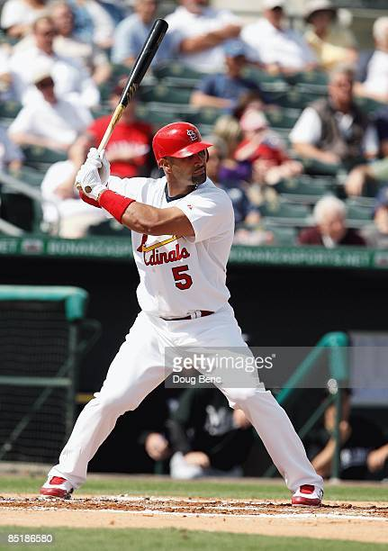 Albert Pujols of the St Louis Cardinals bats against the Florida Marlins during a spring training game at Roger Dean Stadium on February 25 2009 in...