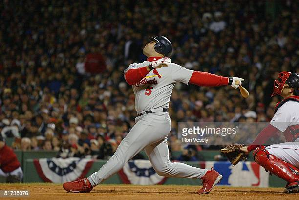 Albert Pujols of the St Louis Cardinals bats during game one of the 2004 World Series against the Boston Red Sox at Fenway Park on October 23 2004 in...