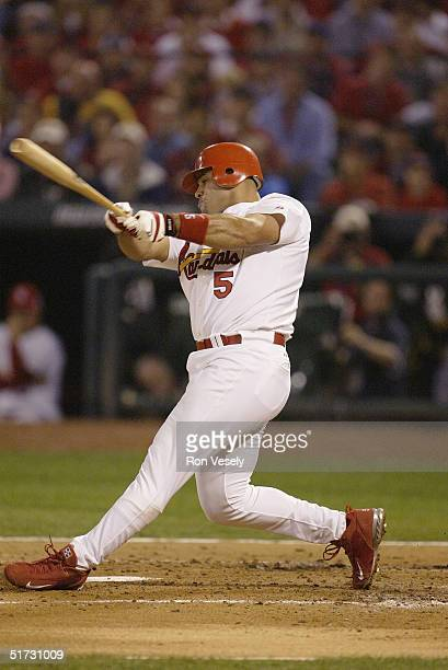 Albert Pujols of the St Louis Cardinals bats during game three of the 2004 World Series against the Boston Red Sox at Busch Stadium on October 26...